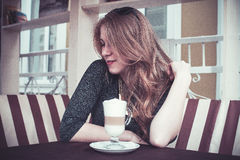 Girl with latte Stock Photo