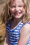 Girl laughing. A beautiful little girl with wet hair and face at the beach Stock Photography