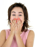 Girl laughing. With her hand over her mouth Royalty Free Stock Photos