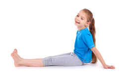 Girl laughing in blue sport's wear Royalty Free Stock Photo