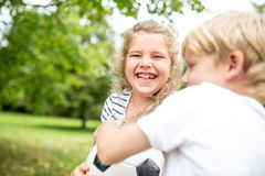 Girl laughing during controversy with brother. About football Royalty Free Stock Images