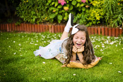 Girl laughing. In the garden Royalty Free Stock Photos
