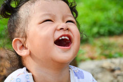 The girl is laughing. Stock Images