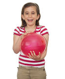 Girl laughing and holding a balloon Royalty Free Stock Photo