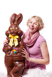 Girl Laughing and Holding a HUGE Chocolate Easter Bunny Stock Photos
