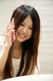 Girl laughing on phone. Young girl laughing on phone Stock Image