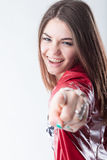 Girl laughing and pointing out. Girl in braces laughing lovely and pointing out her index finger, meaning she has choosen you Royalty Free Stock Photos