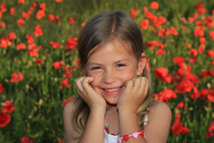 Girl laughing in a poppy field Stock Images