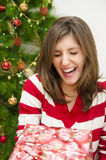 Girl laughing while receiving Christmas gift Royalty Free Stock Photo