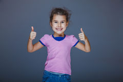 Girl laughing and showing sign yes Stock Image