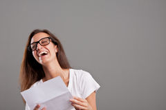Girl laughing about something she read Royalty Free Stock Images