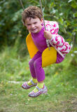 Girl laughing on swing Stock Image