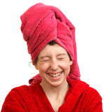 The girl laughs. The girl in a red dressing gown is dared Stock Image