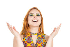 Girl laughs and gestures with her hands. Redheaded girl wearing. Woman is happy, she is laughing a lot and gesturing with her hands. Fashion and colorful makeup Royalty Free Stock Photography
