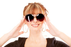 Girl laughs, holding sun glasses Royalty Free Stock Photo