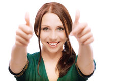 Girl laughs and lifts up thumbs. On white background Stock Photography