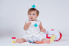 The girl laughs while playing a nurse with pills Stock Images