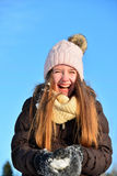 Girl laughs in snow winter Stock Photo