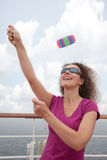 Girl launch kite from deck of ship Royalty Free Stock Photos