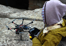 Girl launches a hexacopter. Girl launches six propellers hexacopter stock photo