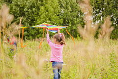 The girl launches a kite. In nature- selective focus Stock Image