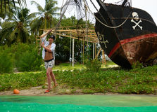 Girl launching pirates boat, adventure. Royalty Free Stock Images