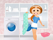 Girl in the laundry Royalty Free Stock Image