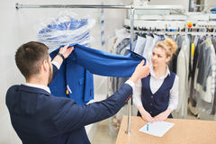 Girl Laundry worker pays into the hands Royalty Free Stock Photos