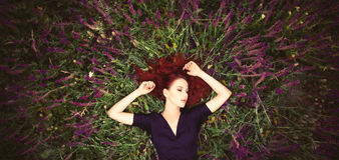 Girl on lavender field Stock Photos