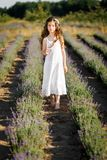 A girl in the lavender field at sunset. A girl smelling lavender flowers. stock image