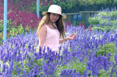 Girl with lavender flower Royalty Free Stock Photo