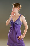 Girl in a lavender negligee Stock Photos