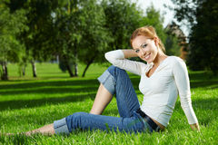 Girl on a lawn Royalty Free Stock Image