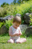 Girl on lawn. A 1 year old caucasian girl playing on a lawn Royalty Free Stock Images