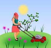 Girl with Lawn Mower. A girl mowing the grass with a lawn mower Royalty Free Stock Photo