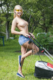 Girl and lawn mower Stock Image