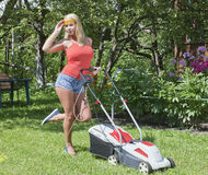 Girl and lawn mower Royalty Free Stock Images