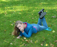 Girl on the lawn Stock Photography