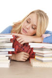 Girl lay on books look side Stock Image