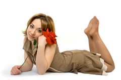 Girl lay on the floor with ros. Es over white Stock Photo