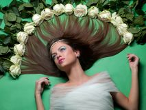 Girl lay among the flowers of roses Royalty Free Stock Photography