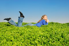 The girl lay on a grass Stock Image