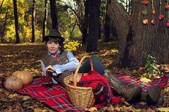 Girl lay on plaid on nature Royalty Free Stock Photography