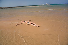 Girl laying on a beach Royalty Free Stock Photography