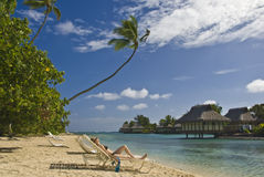 Girl laying on a beach in Moorea Stock Images
