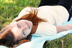 Girl laying on blue towel Royalty Free Stock Photos