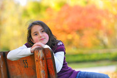 Girl laying down on a bench Royalty Free Stock Images