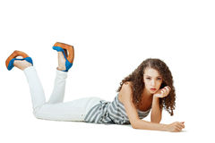 Girl laying on the floor Stock Image