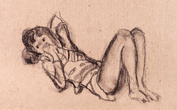 The girl laying on a floor. The girl lays on a floor and has a rest Stock Image
