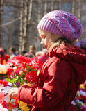 Girl laying flowers at the monument to victory Royalty Free Stock Images
